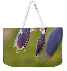 Bokeh Flowers Weekender Tote Bag by Nikki McInnes