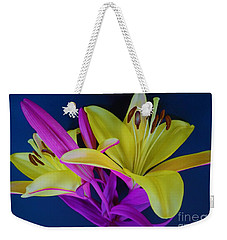 Weekender Tote Bag featuring the photograph Bold Beautiful Flowers by Ray Shrewsberry