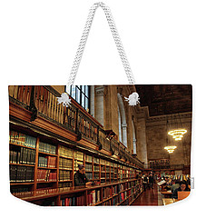 Weekender Tote Bag featuring the photograph Book Browsing by Jessica Jenney