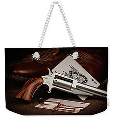 Weekender Tote Bag featuring the photograph Boot Gun Still Life by Tom Mc Nemar
