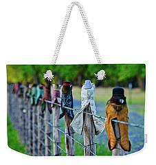 Weekender Tote Bag featuring the photograph Boots On The Fence by Linda Unger