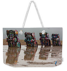 Weekender Tote Bag featuring the photograph Bottoms Up by Stephen Stookey