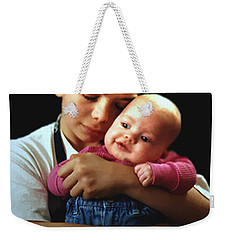 Weekender Tote Bag featuring the photograph Boy With Bald-headed Baby by RC deWinter