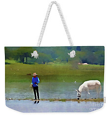 Weekender Tote Bag featuring the photograph Boy With White Burro by John Kolenberg