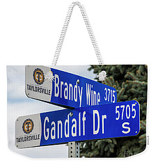 Weekender Tote Bag featuring the photograph Brandywine And Gandalf Street Signs by Gary Whitton