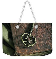 Brass Ornamented Key On Old Brown Book Weekender Tote Bag by Jaroslaw Blaminsky