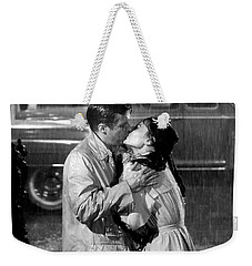 Weekender Tote Bag featuring the photograph Breakfast At Tiffanys Audrey Hepburn And George Peppard by R Muirhead Art
