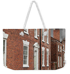Weekender Tote Bag featuring the photograph Brick Buildings by Juli Scalzi