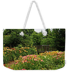 Weekender Tote Bag featuring the photograph Bridge In Daylily Garden by Sandy Keeton