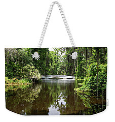Weekender Tote Bag featuring the photograph Bridge In The Garden by Sandy Keeton