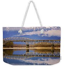 Weekender Tote Bag featuring the photograph Bridge Over Calm Waters by Jordan Blackstone
