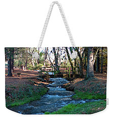 Weekender Tote Bag featuring the photograph Bridge Over Peaceful Waters by Nick Kirby