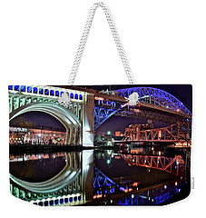 Weekender Tote Bag featuring the photograph Bridges by Frozen in Time Fine Art Photography