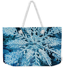 Weekender Tote Bag featuring the photograph Bright Snowflake by Kathy Bassett