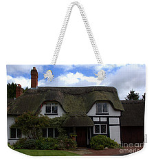 Weekender Tote Bag featuring the photograph British Thatched Cottage by Baggieoldboy