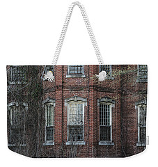 Weekender Tote Bag featuring the photograph Broken Windows On Abandoned Building by Kim Hojnacki