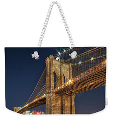 Weekender Tote Bag featuring the photograph Brooklyn Bridge At Night by Mark Dodd