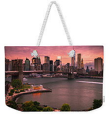 Weekender Tote Bag featuring the photograph Brooklyn Bridge Over New York Skyline At Sunset by Ranjay Mitra