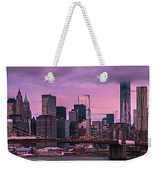 Weekender Tote Bag featuring the photograph Brooklyn Bridge World Trade Center In New York City by Ranjay Mitra