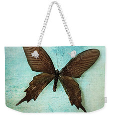 Brown Butterfly Over Blue Textured Background Weekender Tote Bag