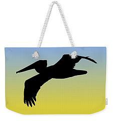 Brown Pelican In Flight Silhouette At Sunrise Weekender Tote Bag