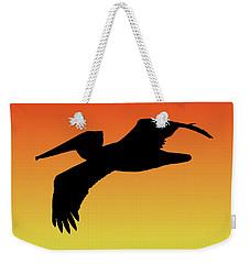 Brown Pelican In Flight Silhouette At Sunset Weekender Tote Bag