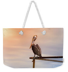 Weekender Tote Bag featuring the photograph Brown Pelican Sunset by Robert Frederick