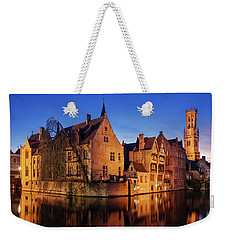 Weekender Tote Bag featuring the photograph Bruges Architecture At Blue Hour by Barry O Carroll