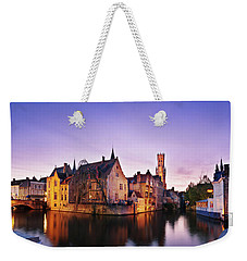 Weekender Tote Bag featuring the photograph Bruges At Dusk by Barry O Carroll