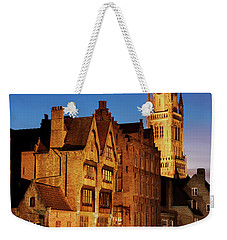 Weekender Tote Bag featuring the photograph Bruges Belfry At Night by Barry O Carroll