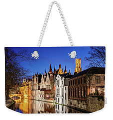 Weekender Tote Bag featuring the photograph Bruges Canal At Night by Barry O Carroll