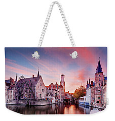 Weekender Tote Bag featuring the photograph Bruges Sunset by Barry O Carroll