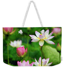Weekender Tote Bag featuring the photograph Brushed Lotus by Edward Kreis