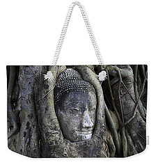 Weekender Tote Bag featuring the photograph Buddha Head In Tree by Adrian Evans