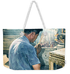 Weekender Tote Bag featuring the photograph Buddhist Way Of Praying by Heiko Koehrer-Wagner