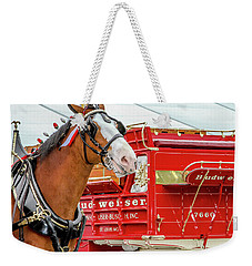 Weekender Tote Bag featuring the photograph Budweiser Clydesdale In Full Dress by Bill Gallagher