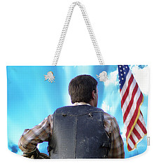 Weekender Tote Bag featuring the photograph Bull Rider by Brian Wallace
