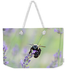 Weekender Tote Bag featuring the photograph Bumblebee On The Lavender Field by Andrea Anderegg