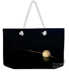 Weekender Tote Bag featuring the photograph Buoy At Night by Stephen Mitchell