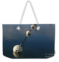 Weekender Tote Bag featuring the photograph Buoys In Aligtnment by Stephen Mitchell