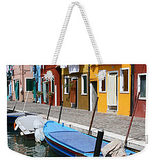 Weekender Tote Bag featuring the photograph Burano Corner With Laundry by Donna Corless