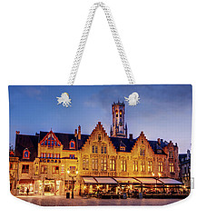 Weekender Tote Bag featuring the photograph Burg Square Architecture At Night - Bruges by Barry O Carroll