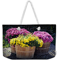 Weekender Tote Bag featuring the photograph Bushels Of Fall Flowers by AJ Schibig