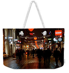 Weekender Tote Bag featuring the photograph Busy Shoppers by Inge Riis McDonald