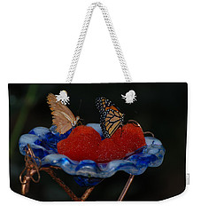 Weekender Tote Bag featuring the photograph Butterfly Fruit by Richard Bryce and Family