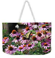 Weekender Tote Bag featuring the photograph Butterfly On Coneflowers by Trina Ansel
