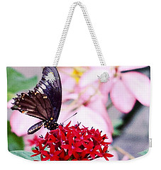 Black Butterfly On Red Flower Weekender Tote Bag by Sandy Taylor