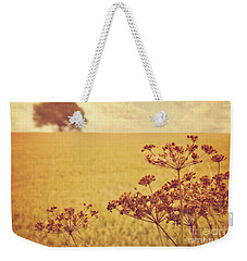 Weekender Tote Bag featuring the photograph By The Side Of The Wheat Field by Lyn Randle