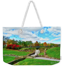 Weekender Tote Bag featuring the photograph By The Waterfall by Kathy Baccari
