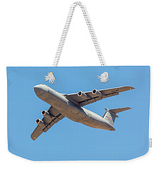 Weekender Tote Bag featuring the photograph C5 Galaxy In Flight by SR Green